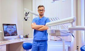 a pediatric dentist wearing eyeglasses