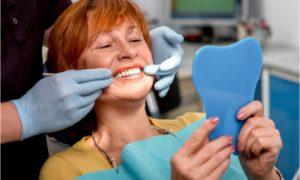 The patient is getting a denture reline procedure.